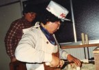 Mrs. Hiroi at work with Jan watching. 1982.