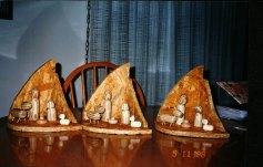A nativity scene made of tops.