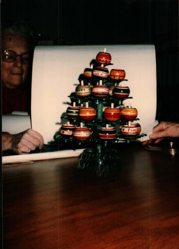 A Christmas tree made of tops.