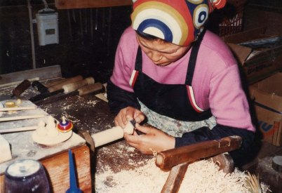Mrs. Hiroi at the lathe.