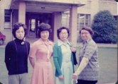 Janell with three Miyagi Gakuin English Department staff outside the administration building.