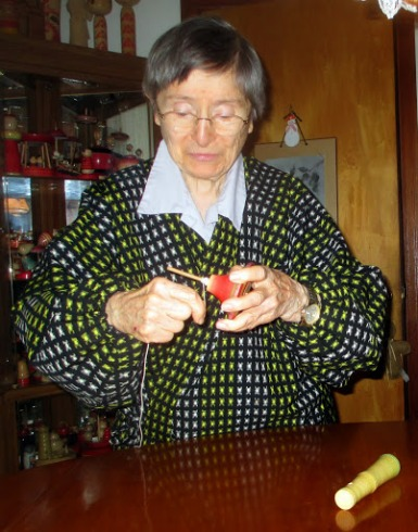Janell demonstrates how to wrap the string of a top.